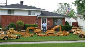 A YARD FULL OF WOODEN CONSTRUCTION EQUIPMENT MODELS IN LARGE SCALE