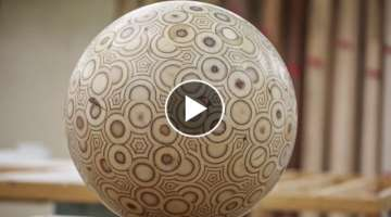 Guy makes a big ball out of plywood