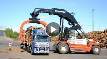 Svetruck TMF 28-21 unloading Volvo FH12 6x2 Timber Truck