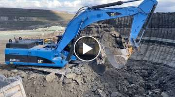 Cat 345C Excavator Loading Trucks