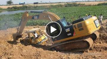 Bulldozer stuck in deep mud & recovery