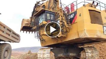 Cat 6040 Excavator Loading Hitachi Dumpers, Operator View