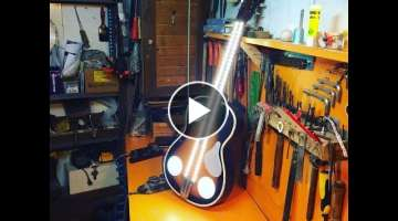 Turn a guitar into a ceiling light fixture
