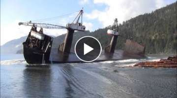 Log barges purposely lean the ship to one side in order to dump the wood
