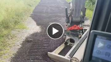 Levelling road planings on a farm track