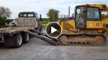 John Deere 650J Dozer side load