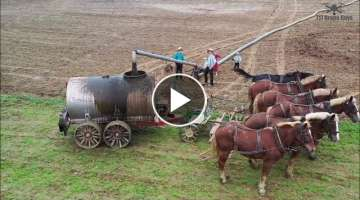Epic 4K drone video of Amish children, 6 horses spreading liquid manure in Pennsylvania, USA.