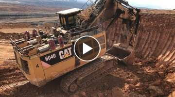 Cat 6040 Mining Excavator Loading Hitachi EH3500 Dumpers
