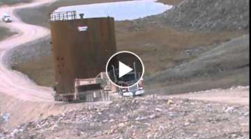 Steel Tanks 34'D 40'H 80,000 Lbs. climbing steep 18% grade on Baffin Island in Arctic Circle