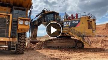 Huge Cat 6040 Mining Excavator Loading Hitachi And Terex Dumpers
