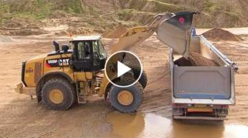 New Cat 980M Wheelloader Loading Volvo FH12 Semi Trucks