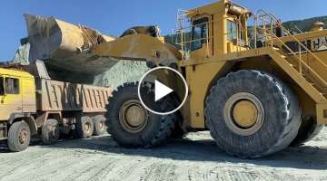 Caterpillar 990F Wheel Loader Loading Trucks With Two Passes