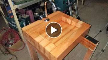 Wooden sink with polyester finish