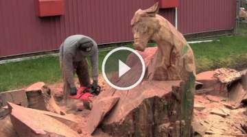 Jordan Anderson carving bull elk with chainsaw
